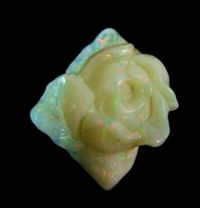 A rose carved from a chunk of opaque white opal from Coober Pedy