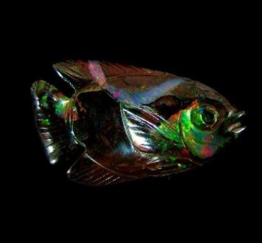 Boulder opal fish carving
