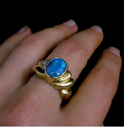 Opal Photography of Ring on Finger