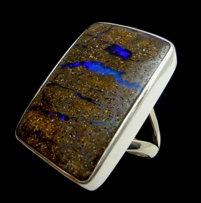 Boulder opal ring with natural strips of blue