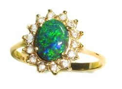 black opal from Australia set in gold ring with diamonds surrounding the opal