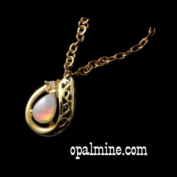 crystal opal drop set in gold with one small diamond