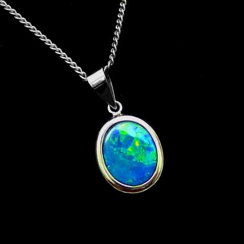 Opal pendant green blue opal pendant set in 14k white gold aloadofball Gallery