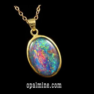 opal pendant set in sterling silver gold finish showing brilliant reds and greens