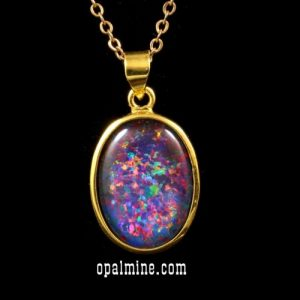 brilliant triplet opal with lots of red set in gold plated silver