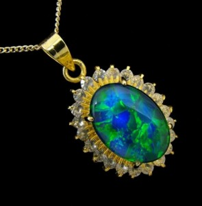 opal pendant with multiple stone surround