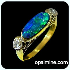 black Australian opal set in 18k gold ring with diamonds.
