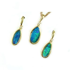 Buy Opal Jewellery Online. In this case a beautiful set of boulder opal drops set in yellow gold with green blue features