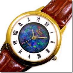 opal-watches- mosaic opal face with leather band. round face