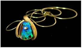 opals-boulder opal pendant with diamond in stone